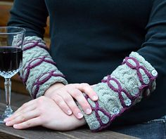 Not wanting to stop knitting colored cables, Linked In Cuffs applies the artist cables from the Linked In Cowl on a trendy accessory for your wrists. Featuring three colored cables on each wrist, seven smaller buttons to ensure a perfect fit, and a contrasting color bind off, customized your Linked In Cuffs to suit your color aesthetic. Ideal to wear while sipping Pinot on the deck at sunset or while rambling through the fall woods, the organic cotton will keep your arms ... #giftalong2014