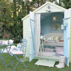 Convert tool shed to outdoor sitting area.  Super Cute!