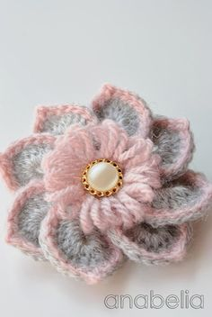 Crochet flower by Anabelia. She has a tutorial and also links to the button and center loop stitch techniques.