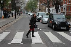 Many times when I travel I am the epitome of a tourist; cameradangling around myneck, guidebook grasped inmy hands andstops at all the mostvisited tourist attractions. The only representation lacking is the white tennis shoes. I don't do white tennis shoes.  I absolutelycould not returnfromthis trip withouttaking a walk on the iconic Abbey Road