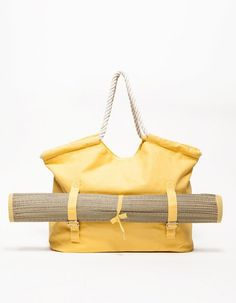 This sunny canvas tote comes with a coordinating beach mat.