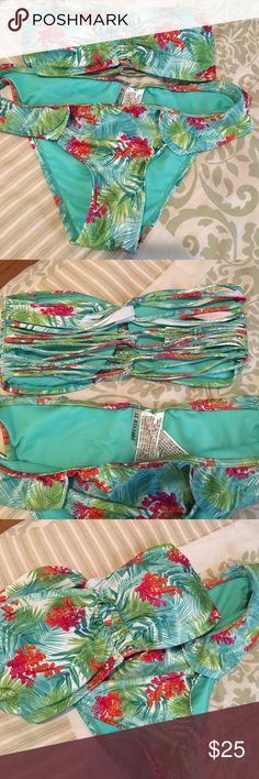 Bikini Cute bandeau style bikini. Top is size small, bottom is medium. Bought for my daughter but never worn. Forever 21 Swim Bikinis