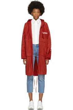 Long sleeve technical satin coat in red. Concealed drawstring at hood. Two-way zip closure at front. Logo printed in white at chest. Flap pockets at waist. Logo printed in white at sleeves. Elasticized cuffs. Drawstring at hem. Eyelet vents at back yoke. Rain shield. Tonal and gunmetal-tone hardware. Tonal stitching.