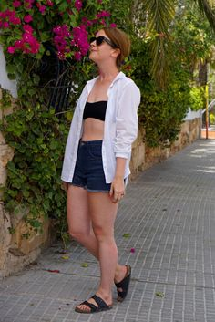 High waisted jeans, bikini top, white cotton shirt and Birkenstock sandals