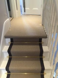 hallway flooring Grey Carpet with Black Border and Golden Stair Rods to Stairs Hallway Carpet, Hallway Flooring, Bedroom Carpet, Carpet Runner On Stairs, Staircase With Runner, Stair Runner Rods, Dark Staircase, Striped Carpet Stairs, Stairway Carpet