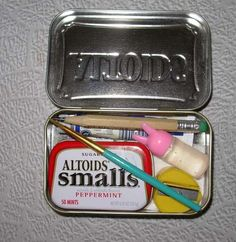 watercolor kit in mini Altoids tin with tools inside larger Altoids tin