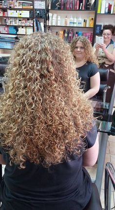 tight perm in long hair