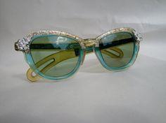 How goregous are these! Vintage cateye sunglasses rockabilly Mad Men frames eyewear 1960s Aqua or blue green. $32.00, via Etsy.