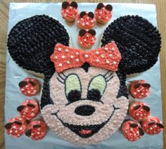"""Meg's Cakes and Bakes! Minnie Mouse Cake and Matching Cupcakes.  Cake is made with a 10"""" round pan for the face, and 2 6-7"""" pans for the ears. I used a cookie cutter in the shape of a bell as a chocolate mold to make the bow (2 sideways bells put together). I used the chocolate wafers you buy for candy making at the bulk store to make the ears on the cupcakes :)"""