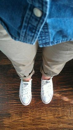 denim button-up, khakis, white tennis shoes