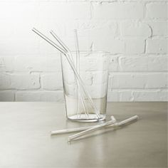 Shop Set of 8 Glass Straws. Elevate cocktailing with a reusable sipper. Made from ultra-durable beaker glass, this straw sips at the perfect angle, then comes clean in the dishwasher. glass straws set of eight is a exclusive. Eco Friendly Cleaning Products, Perfect Angle, How To Cook Shrimp, Do It Yourself Home, Green Life, Green Building, Things To Buy, Kitchenware, Dinnerware