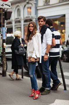 Stylish couple: Olivia Palermo & Johannes Huebl // white jacket, skinny jeans & strappy red heels #style #fashion #streetstyle