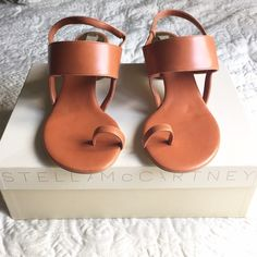 Stella McCartney cognac sandals These were worn only ONCE. wear is shown on the bottom. the bottom is a painted gold metallic. The color is a gorgeous cognac. Stretchy back strap  a very classic style.  Authentic. The heel is round and patent leather and has absolutely no scuffs !  Comes with original box and dust bag ☺️ Stella McCartney Shoes Sandals