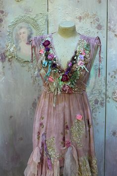 Romantic long vintage cotton dress, altered couture, hand dyed in shades of mauve and dusty pinks; reworked with vintage and antique textiles and laces, inspired by baroque era and shades of nature. The neckline is adorned with various vintage and antique textiles, silks and laces, handmade blooms, purple petals and seed beading/crystals. The hem is layered with silks, tulle, lace..accentuated pink rose petals here and there., the underskirt has charming cutwork lace flounce with butterflies…