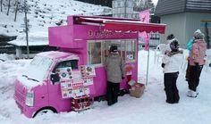 Pink drive-up noodle shop at the base of Hakuba Happo