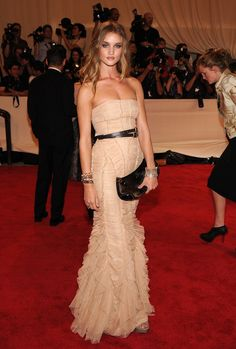 Rosie Huntington-Whitley on the red carpet with double cuffed arms