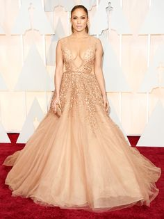 Jennifer Lopez the Oscars presenter in blush-hued beaded gown by Elie Saab. The star accessorized with a Salvatore Ferragamo clutch and 20 carats of Neil Lane diamond and platinum jewelry at the 2015 Academy Awards on Sunday, Feb. 22, in Hollywood.