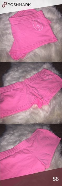 Pink shorts - loungewear These shorts are great for hanging out or to sleep in . White peace sign on lower right side . 60% cotton ,40% polyester . Intimates & Sleepwear Pajamas