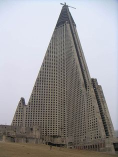 The Ryugyong Hotel, a 105-storey skyscraper in Pyongyang, North Korea. It is pictured here before the resumption of contruction in 2004. Though the hotel is now glass-covered, it is rumoured to still be empty