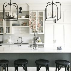 no way is this a boring white kitchen - fabulous kitchen by interior designer Vanessa Francis - beautiful cabinetry accented sith charcoal gray and black - it is the epitome of neo-traditional - young-fresh interior design