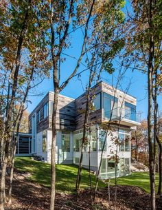 Architect Christopher Simmonds has recently completed a single family home in Quebec, Canada. This modern house, set into the dense foliage of the hills north Residential Architecture, Modern Architecture, Beautiful Buildings, Beautiful Homes, Quebec, Clad Home, Wooden Facade, Forest House, House And Home Magazine