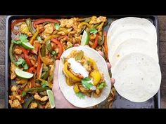 These Chicken Fajitas are a quick and easy one pan meal packed with smoky sweet fajita flavors. It takes just 5 minutes to prepare and 20 minutes in the oven for a delicious and healthy dinner with minimal cleanup. See how to make them!