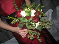 #red #winter #bridesmaid #bouquet