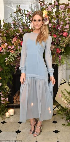 Coming up roses: Poppy Delevingne looked incredible in a flowing blue gown with a semi-she...
