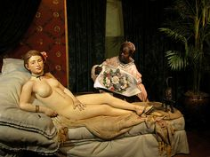 this is a statue of the painting Olympia by Manet