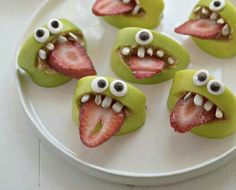 Apples, strawberries, sunflower seeds, nut butter and googly eyes.