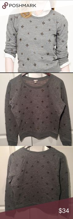 J. Crew Gray Beaded Sweatshirt S J. Crew gray beaded sweatshirt - size small. A classic, comfy favorite gets a little fancy with bead, sequin, and crystal embellishments. There are a few loose beads - the last photo is of the only spot with several missing (on the elbow), but the others are barely noticeable. In great condition - always hand-washed and laid flat to dry. J. Crew Tops Sweatshirts & Hoodies