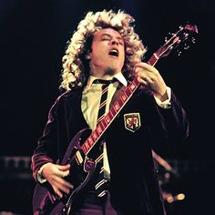 Angus Young.  Nobody - and I do mean, nobody - will ever rock as hard while wearing a schoolboy's short pants and tie as Angus Young.  And, he looks so cool doing it.