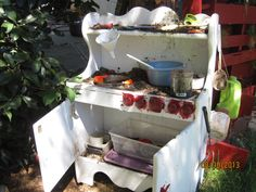 """a free kids kitchen- turned into an outdoor mud kitchen in the yard... had some extra kitchen """"things""""... make mud pies, mud muffins, or mud soup- yum!"""