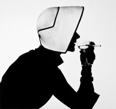 Irving Penn, Lisa Fonssagrives wearing Christian Dior hat with Martini, 1952