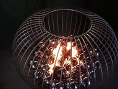 Fire FeaturesStainless Steel Fire Cage Curved Stainless Steel Rods w. Steel Orbs 4ft, 6ft diameter. Available in all materials in custom sizes.