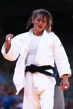 LONDON, ENGLAND - JULY 28: Sarah Menezes of Brazil celebrates her win over Cedric Mandembo Kebika of Democratic Republic of the Congo in the Women's -48 kg Judo on Day 1 of the London 2012 Olympic Games at ExCeL on July 28, 2012 in London, England. (Photo by Cameron Spencer/Getty Images)