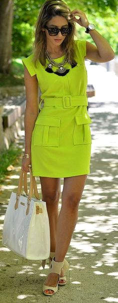 When rocking neon, keep accessories simple with one or two bangles and a large statement necklace. Throw on a black blazer to tone the bright look down.