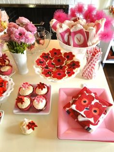 Violet's birthday party via with two cats. www.withtwocats.com #birthday #party #parties #dessert #cupcakes #food #flowers #pink #red #cookies #ranunculas #poppies #favors #monogram #wands