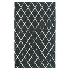 New Zealand wool rug with a lattice-inspired design in black. Hand-woven in India.   Product: RugConstruction Material: 100% New Zealand blended woolColor: BlackFeatures: Hand-wovenMade in IndiaNote: Please be aware that actual colors may vary from those shown on your screen. Accent rugs may also not show the entire pattern that the corresponding area rugs have.