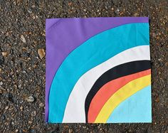 Learn how to sew improvisational curved quilt blocks with this great tutorial. Use the stack and slash method to sew 4 blocks at once.