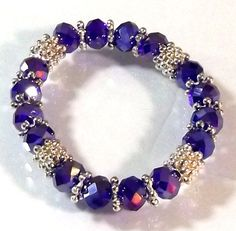 Today only! Get special deal of the day! Be fearlessly glam in this glitzy glass beads coil bracelet. Shop now: https://www.noblag.com/silver-tone-glass-beaded-stretch-purple-bracelet.html