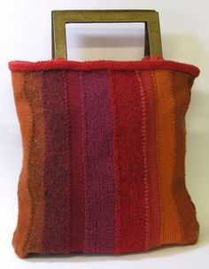 Bag knitted in panels using multiple yarns