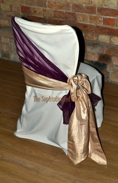Burgundy Organza Shawl with Gold Satin Side Bow on Ivory Chair Cover  www.tablescapesbydesign.com https://www.facebook.com/pages/Tablescapes-By-Design/129811416695