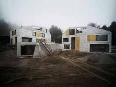 "From the architecture studio of Andreas Fuhrimann and Gabrielle Hächler comes this pair of sculptural concrete houses overlooking Lake Zurich in Switzerland. Conceived as two polygonal boulders that visually complement each other, together the residences form the ""Villa Ensemble"" complex, and are connected via a shared underground vault which contains a parking space and fully-equipped wellness area."