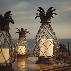 Pineapple Hurricane Lanterns are great for the backyard! Note to self:make pineapple finials Hurricane Lanterns, Candle Lanterns, Passion Deco, British Colonial Style, Beach Themes, Sweet Home, Candle Holders, Outdoor Decor, Outdoor Candles