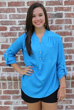 Karlie T4731BLU is another go-to style of top!  The beautiful blue color is perfect for the spring and summer season.  Gold buttons give this shirt that little something extra.  It can be worn with a casual outfit or dressed up for going out to dinner!