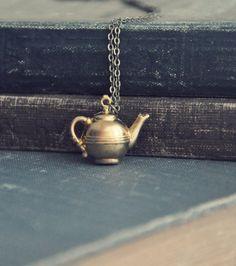 petite teapot necklace ( Etsy:: http://www.etsy.com/listing/97416177/petite-teapot-necklace? )