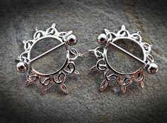 Swirling Sunburst Tribal Shield Nipple Ring with Surgical Steel Barbell Specifications: Surgical Stainless Steel Balls *Sold as a single (add 2 to cart if needing a pair)* Nipple Rings, Belly Rings, Body Jewellery, Body Piercings, Barbell, Jewelery, Bangles, Irezumi Tattoos, Marquesan Tattoos