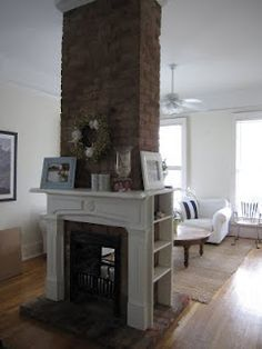 insert wood stove, smaller brick chimney going up to ceiling, built in between posts in basement New Orleans Homes, New Homes, Chimney Decor, Brick Columns, Shotgun House, Double Sided Fireplace, Attic Rooms, Inspired Homes, Home Remodeling