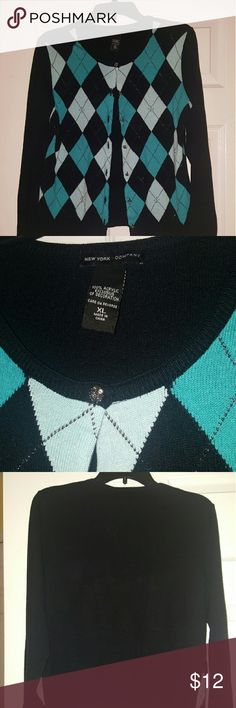 New York & Company Cardigan XL Tiffany blue, light blue and black diamond design with silver sparkly buttons down the front give this sweater a dressier feel.  Perfect to wear to the office and then dinner or for the upcoming holidays. One small snag in the front bottom hem that is barely noticeable when worn. Happy Shopping! New York & Company Sweaters Cardigans